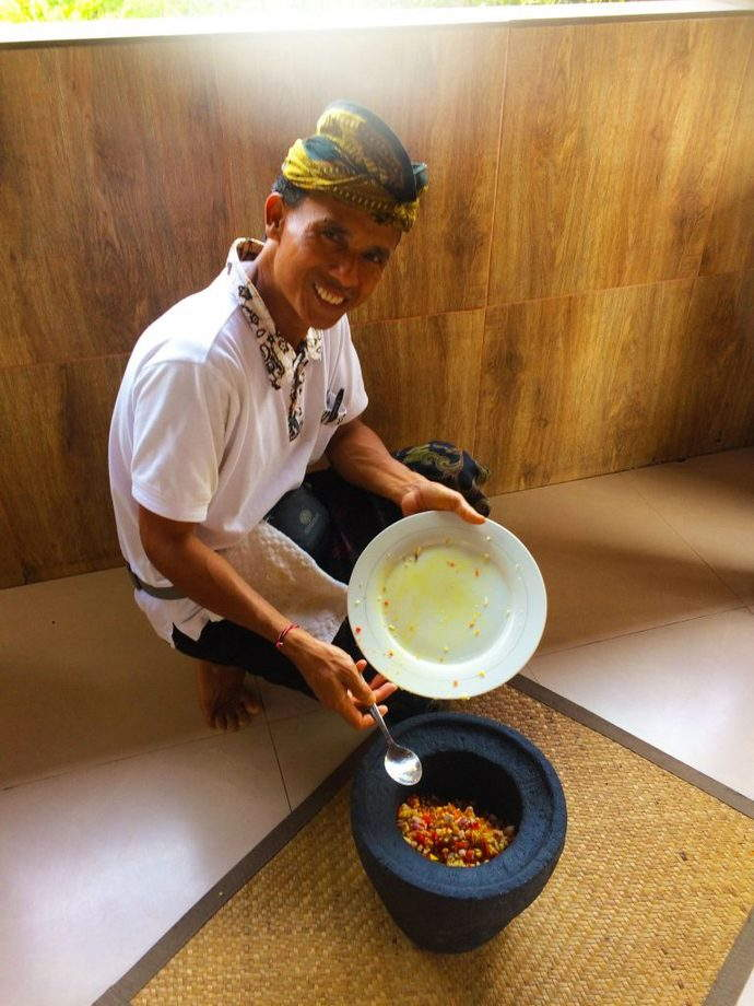 Our Friendly Chef showing us how to use the Balinese Pestle and Mortar